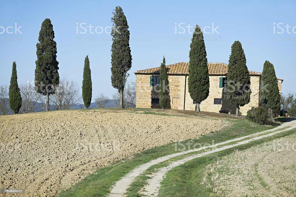 Typical Tuscany landscape and home with cypress trees, Italy. royalty-free stock photo
