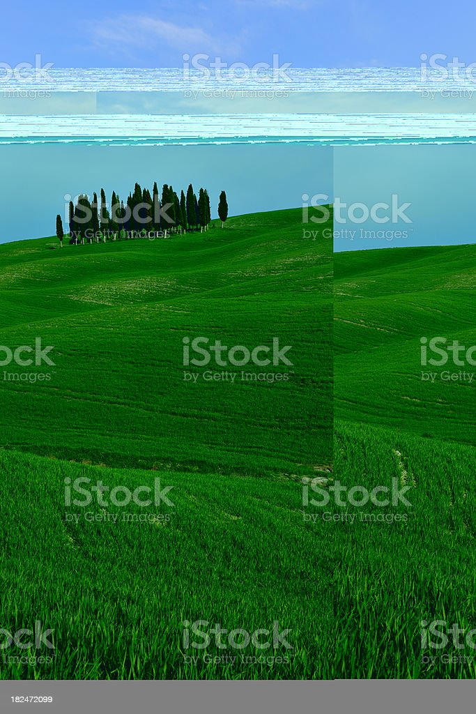Typical Tuscany Landscape with Cypress Trees and Rolling Hills royalty-free stock photo