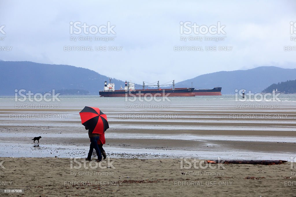 Typical Vancouver British Columbia Beach Stroll In The Rain stock photo