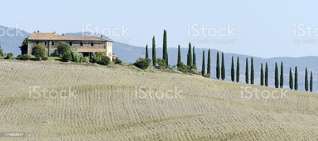 Typical Villa with cypress trees in Crete Senesi, Tuscany, Italy royalty-free stock photo