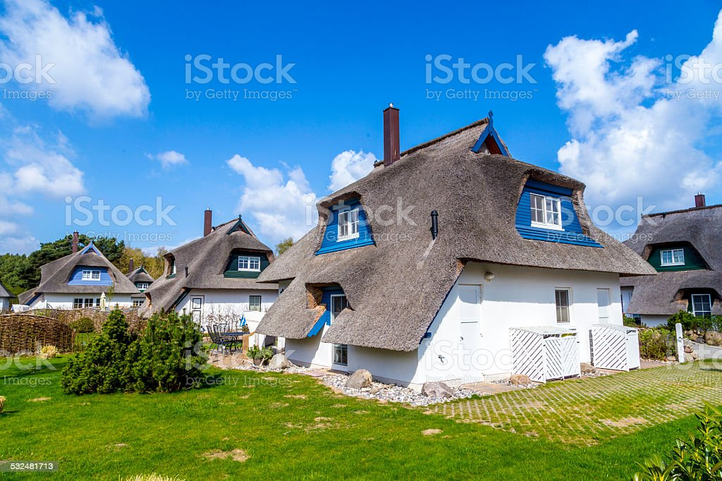 typical village house with reed roof in Usedom stock photo
