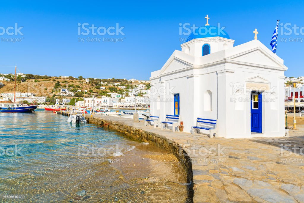 A typical white church in Mykonos fishing port, Cyclades, Greece stock photo