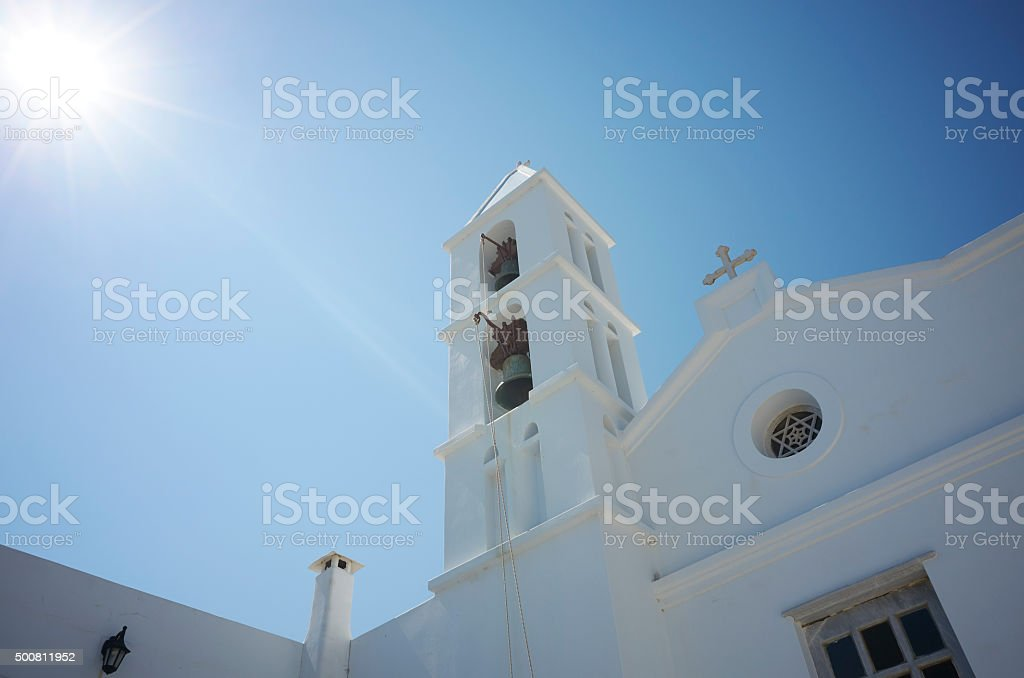 Typical white Greek church on the island Tinos in Greece stock photo