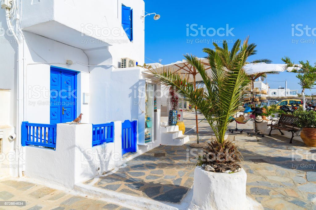 Typical white house on street of Mykonos town on island of Mykonos, Cyclades, Greece stock photo