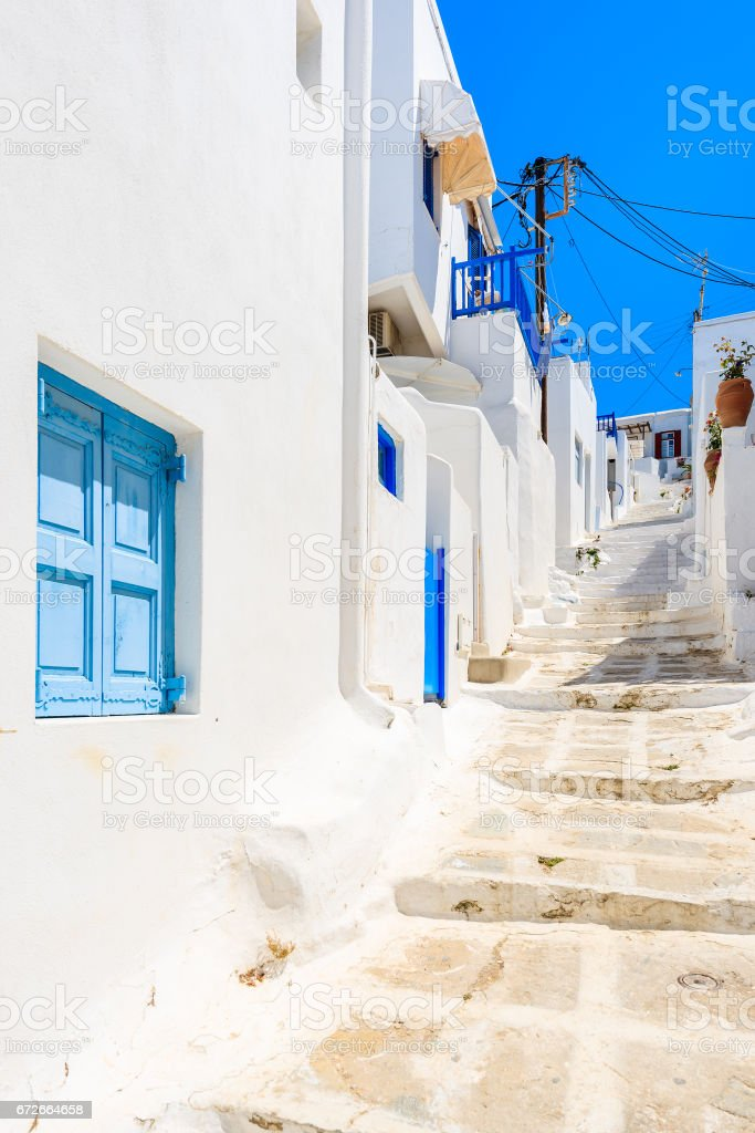 Typical white houses on street of beautiful Mykonos town, Cyclades islands, Greece stock photo