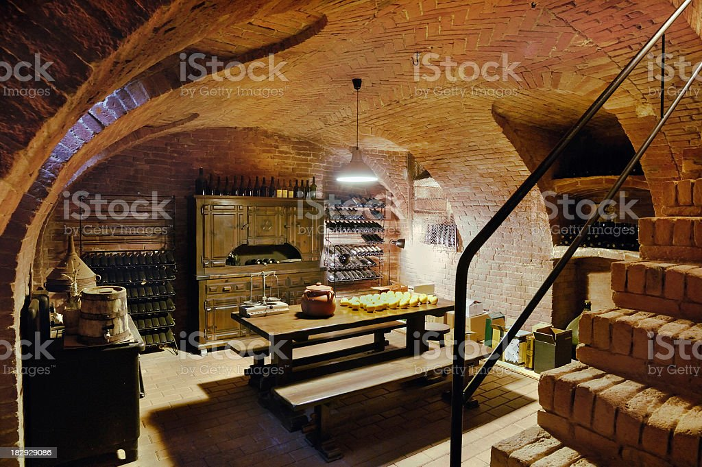 Typical wine cellar of a rustic house, terracotta and wood. royalty-free stock photo