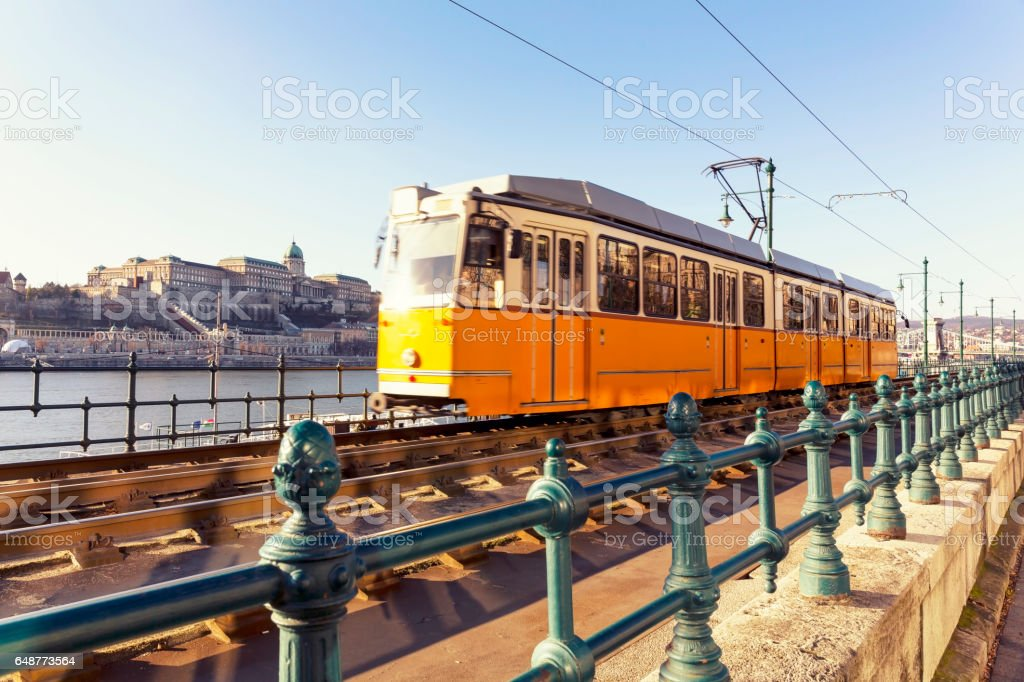 Typical Yellow Tram on the Danube Riverside in Budapest stock photo