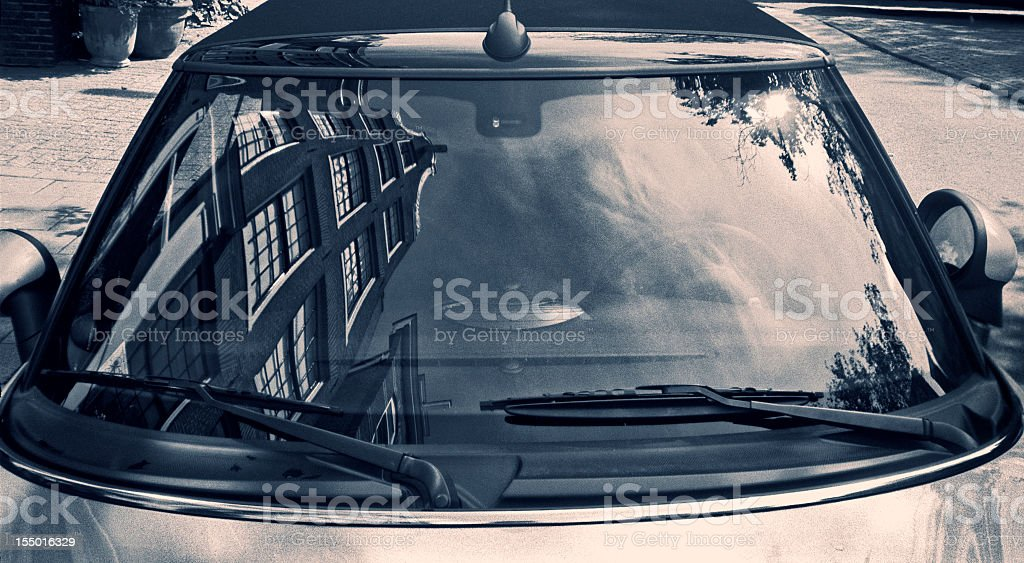 Typically Dutch architecture reflected in a car windscreen stock photo