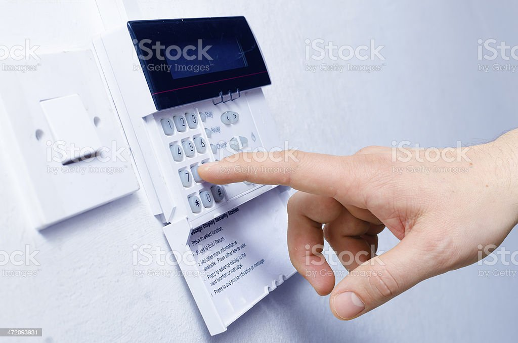 Typing alarm code stock photo