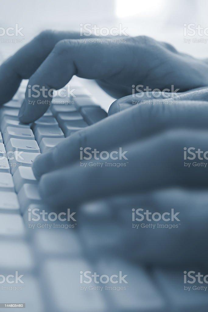 Typing at a Keyboard royalty-free stock photo