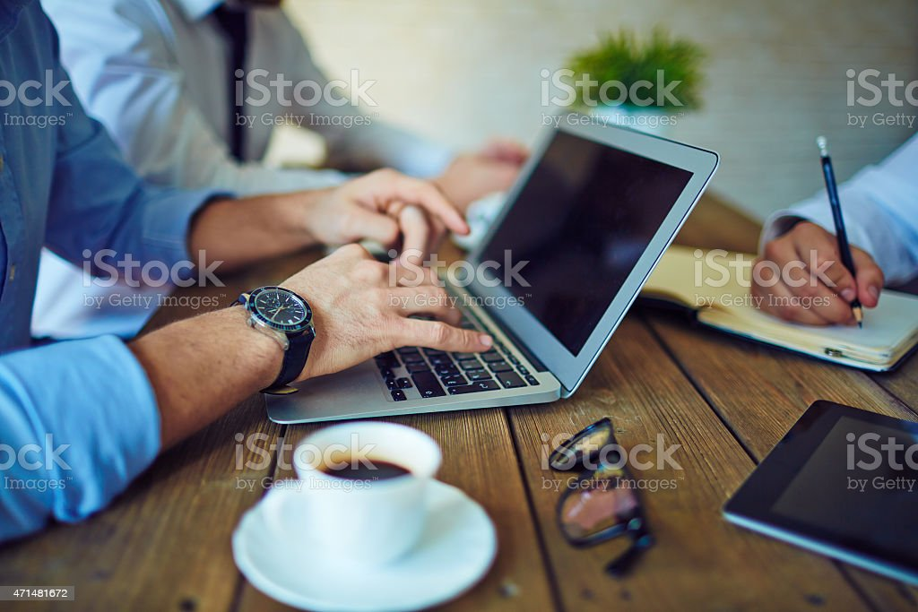 Typing at meeting stock photo