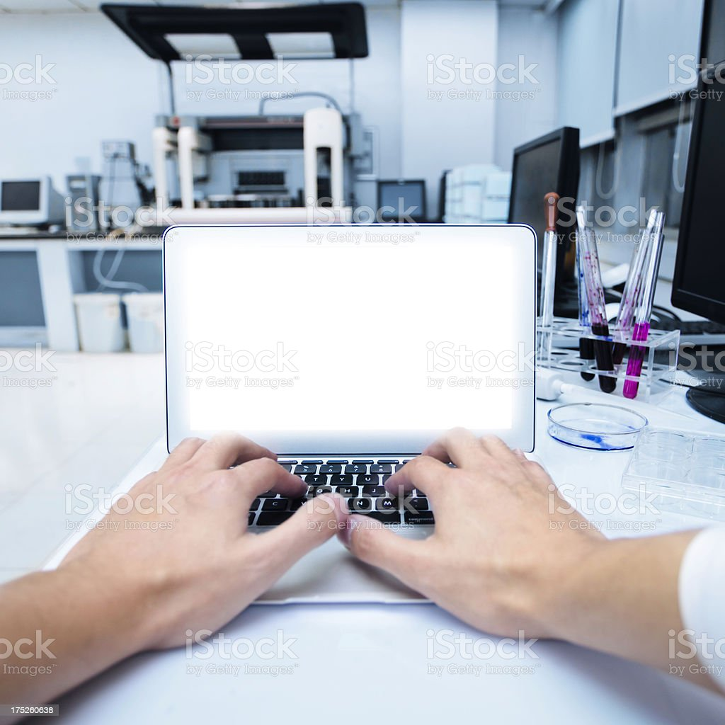 typing in laboratory royalty-free stock photo