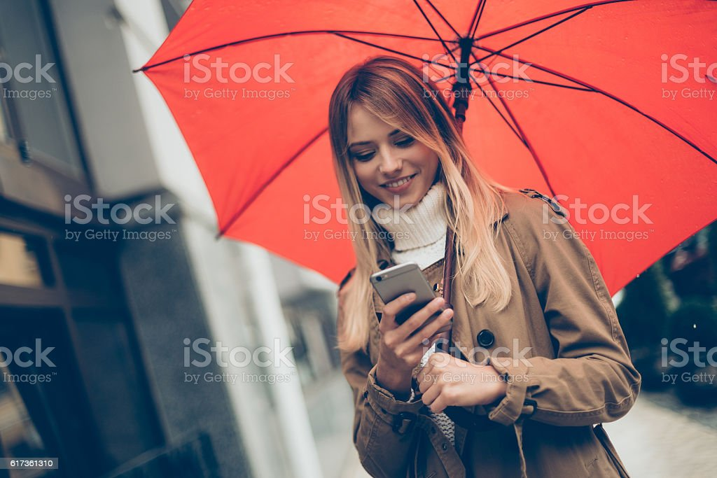 Typing message on the go. stock photo