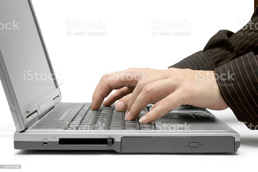 Typing on a Grey Laptop. royalty-free stock photo
