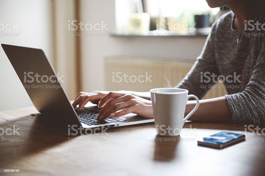 Typing on a laptop keyboard stock photo