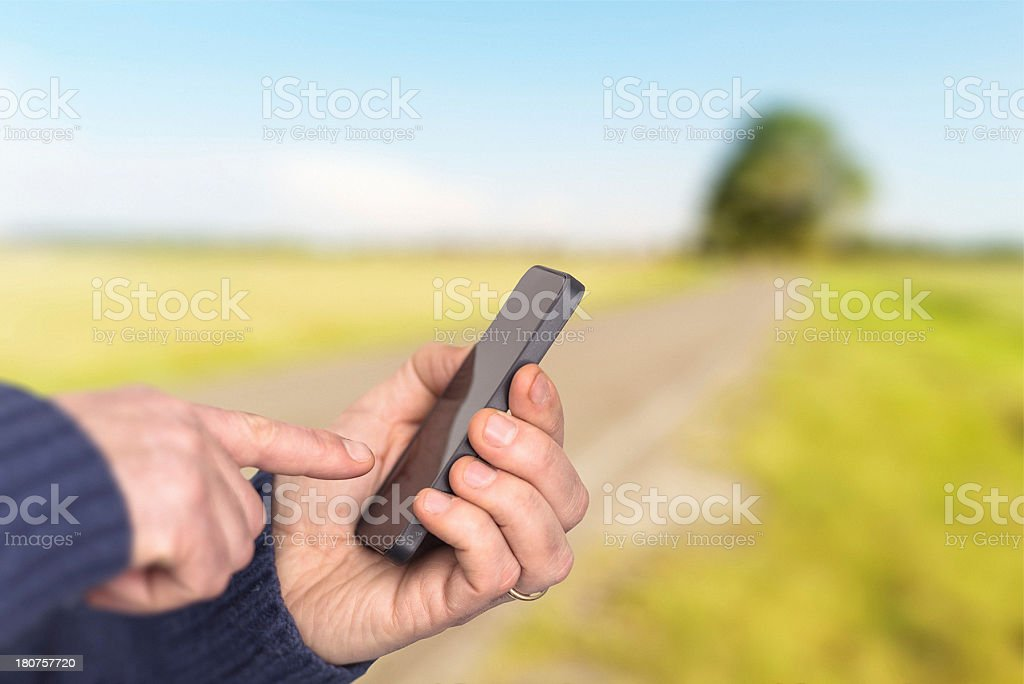 typing on a new mobile phone royalty-free stock photo