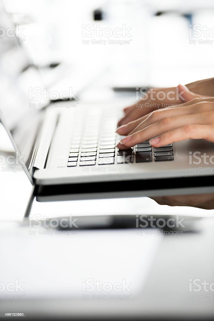 Typing on computer stock photo