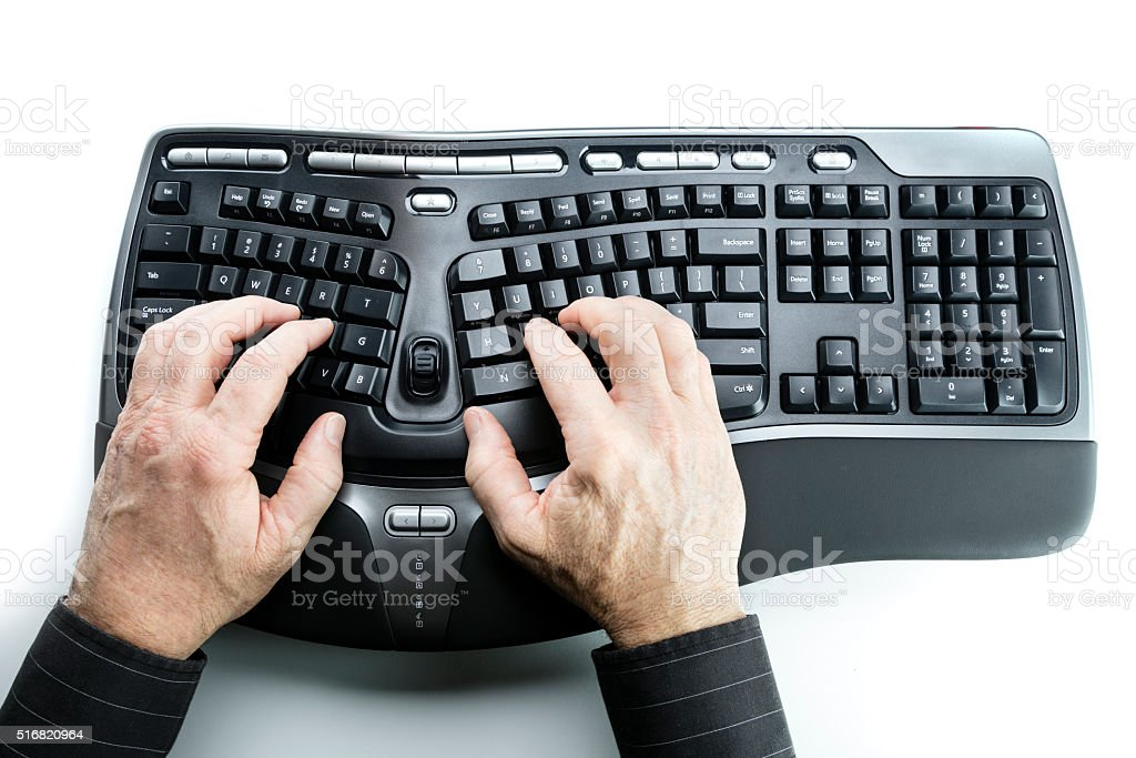 Typing on ergonomic keyboard stock photo