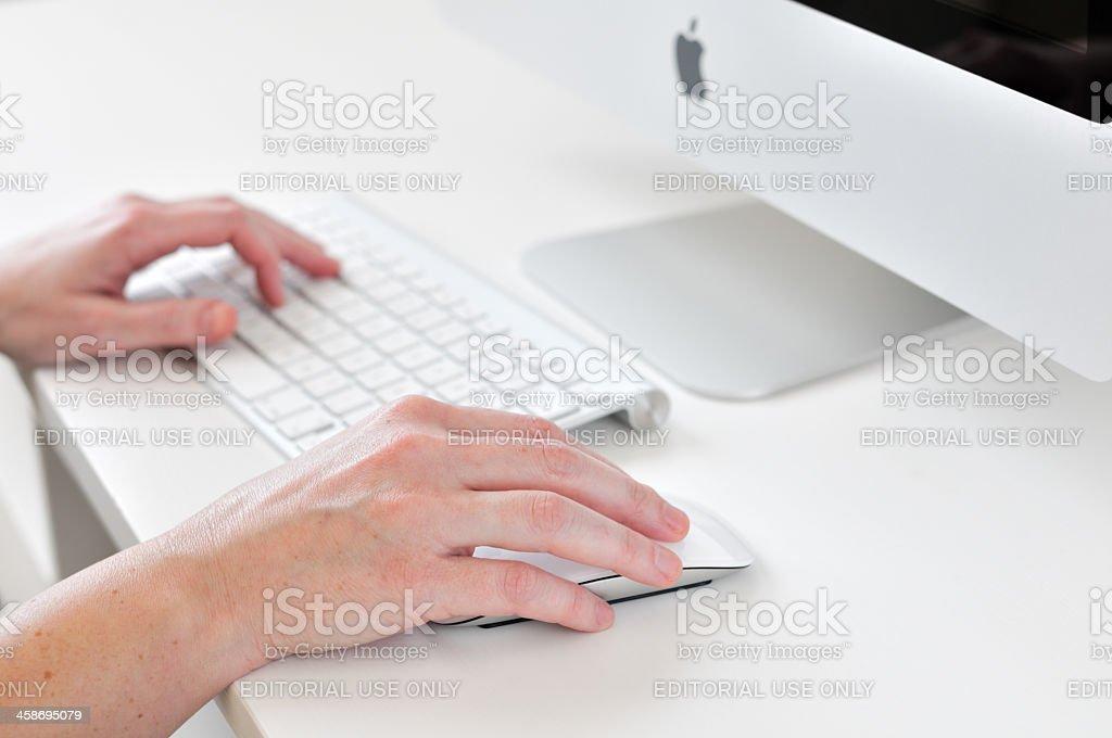 Typing on keyboard royalty-free stock photo