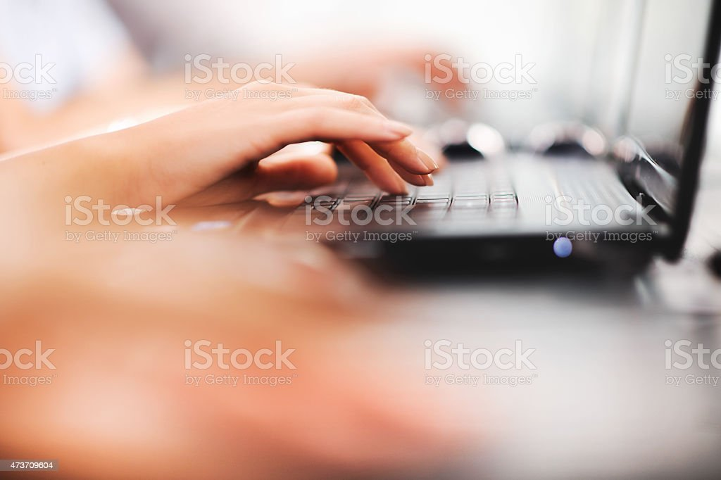 Typing on keyboard. stock photo