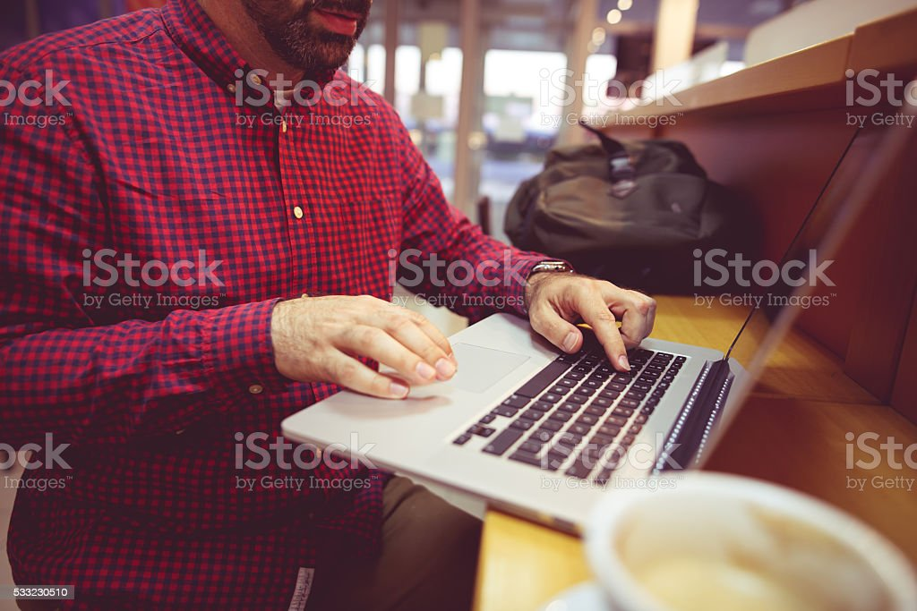 Typing on lap top stock photo