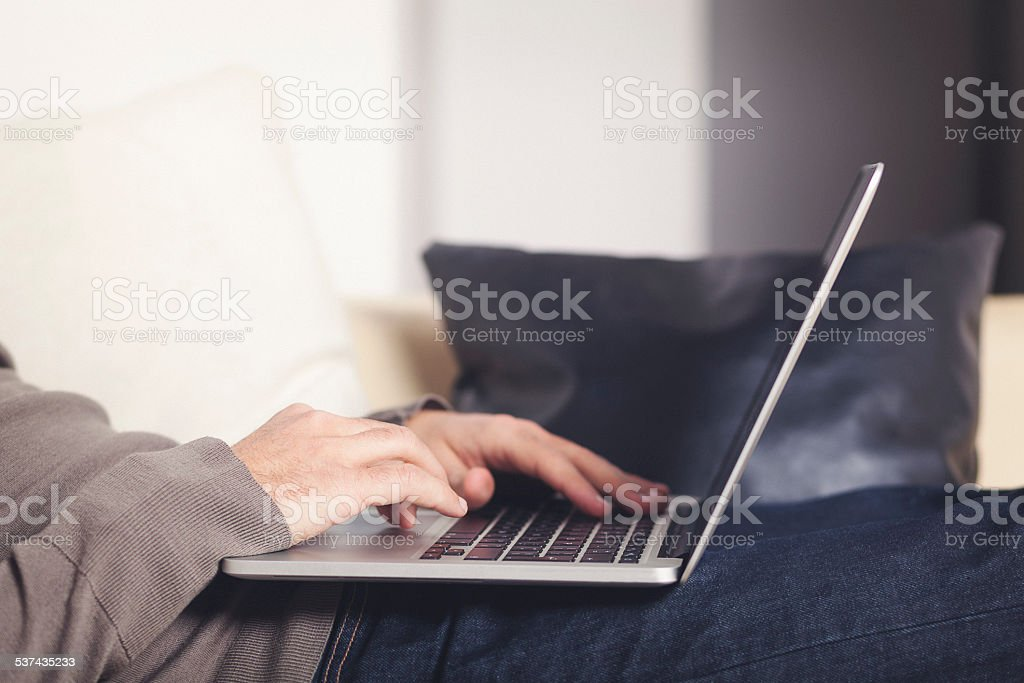 Typing on laptop close up hands and keyboard shot stock photo