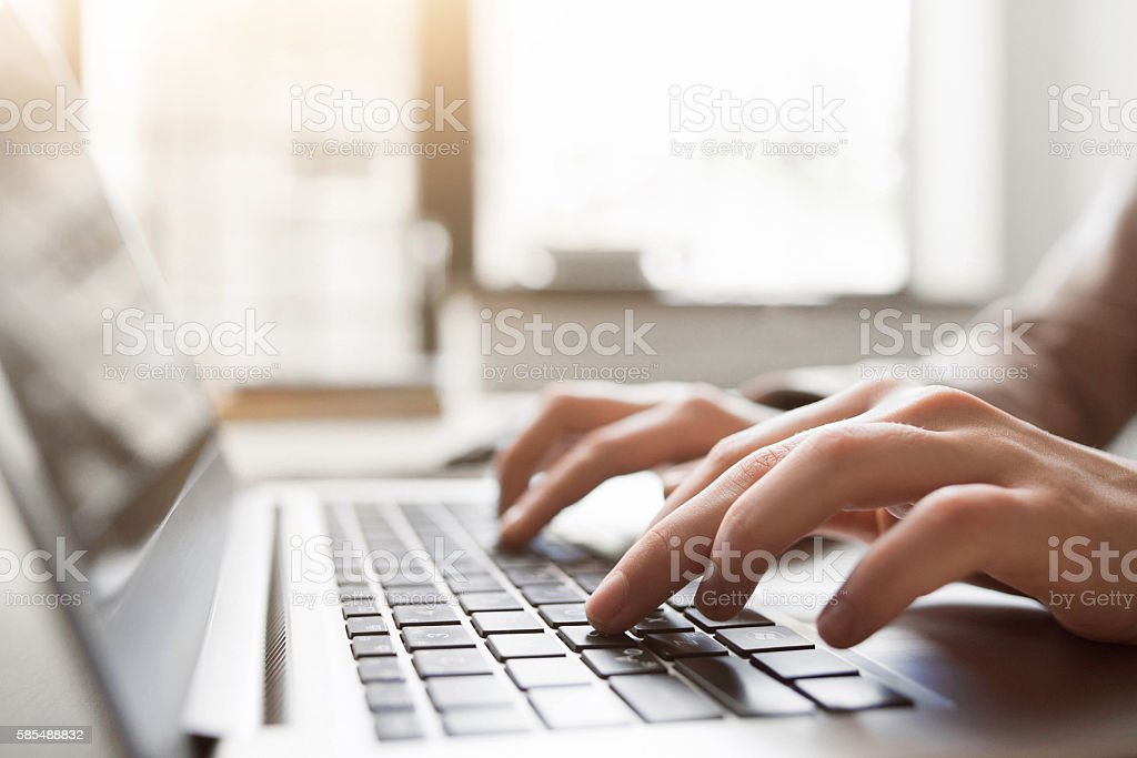 Typing on laptop closeup, chatting in Facebook stock photo