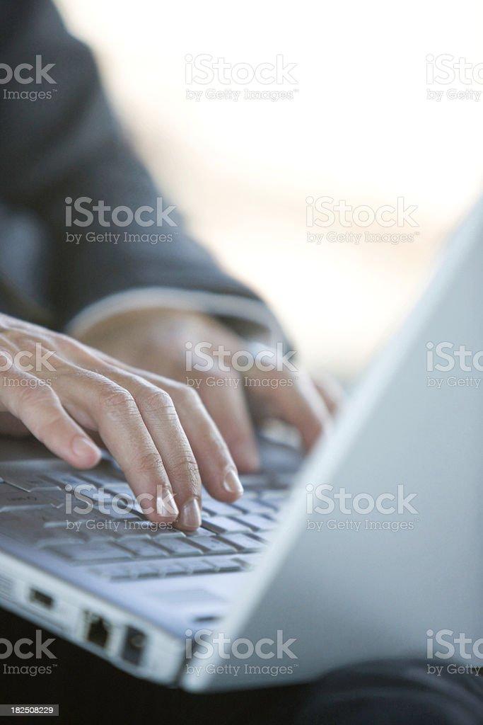 Typing on laptop royalty-free stock photo
