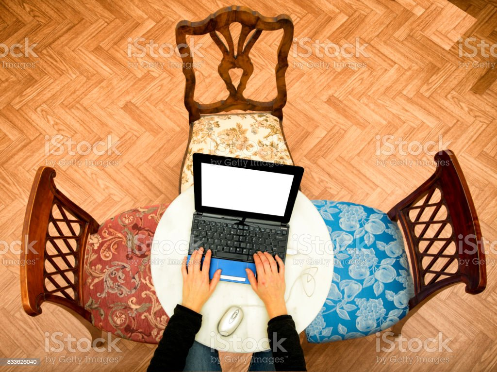 Typing on laptop stock photo