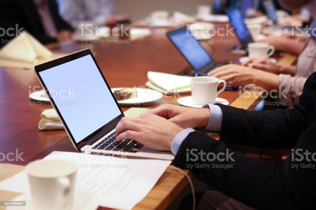 Typing on Laptops During Meeting stock photo