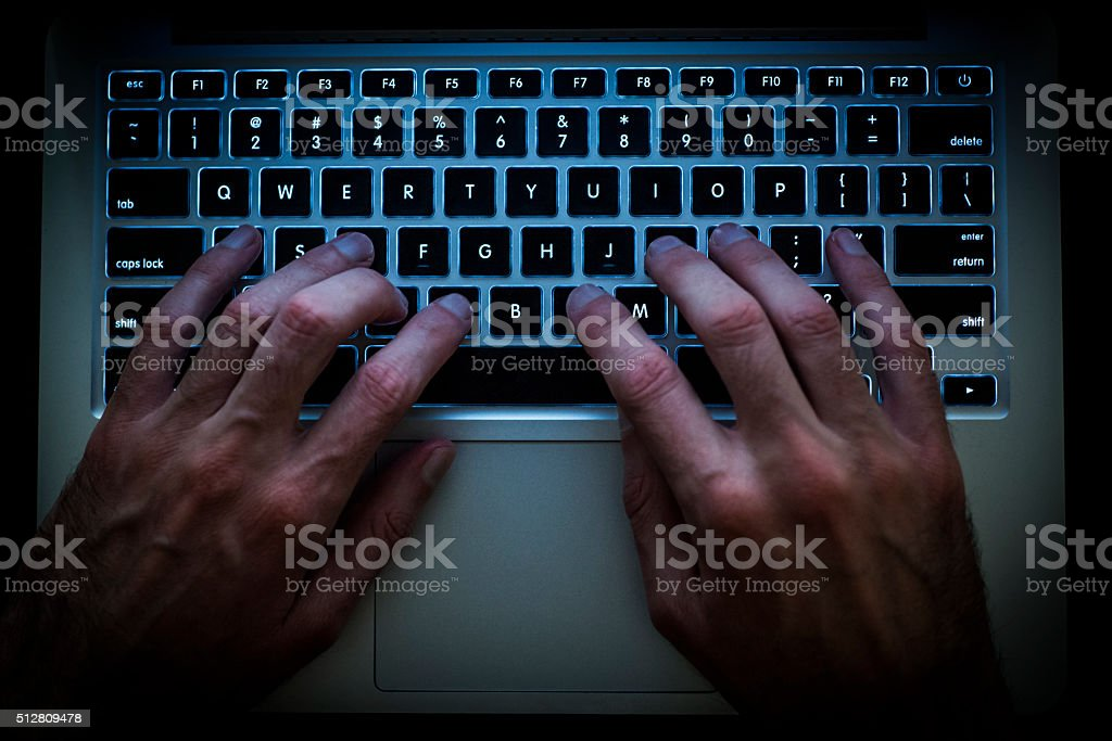 Typing on the computer stock photo