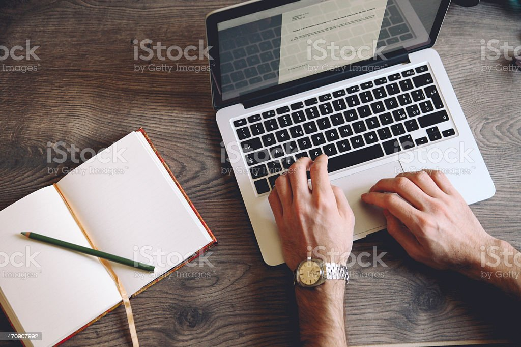 typing on the keyboard stock photo