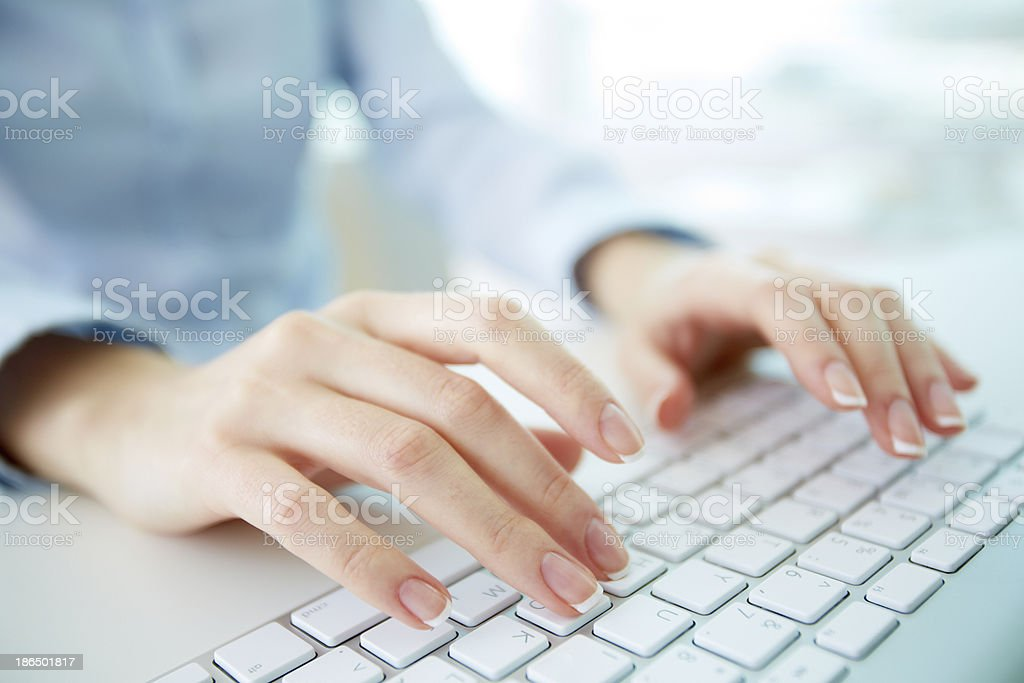 Typing worker stock photo