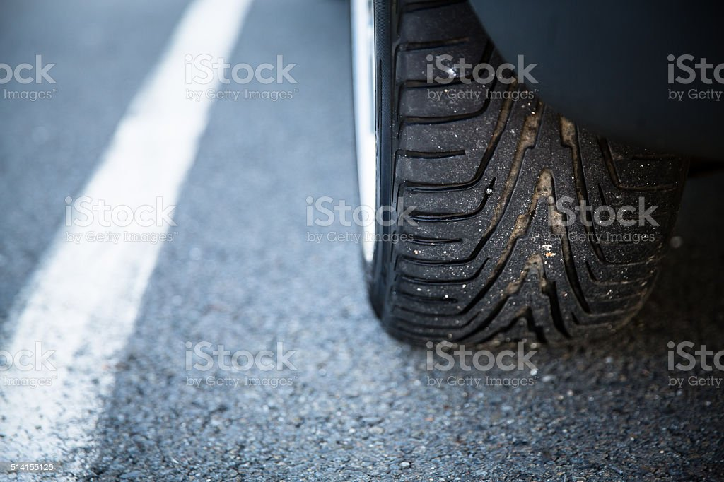 Tyre of a modern car on road stock photo