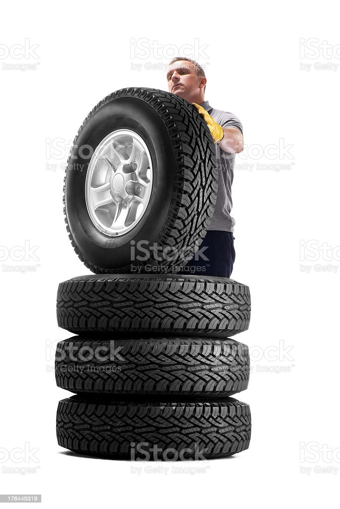 Tyre shop worker royalty-free stock photo