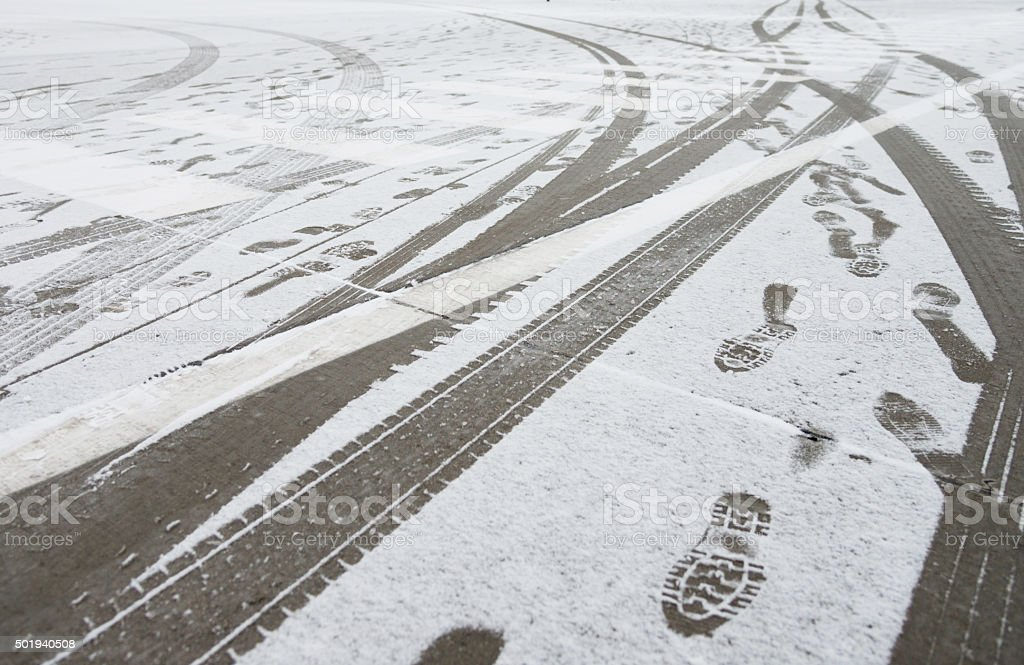 Tyre track and footprint on snow stock photo