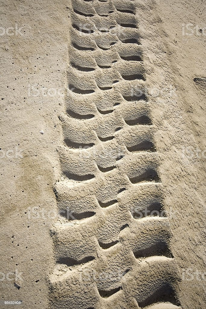 Tyre track in the sand stock photo