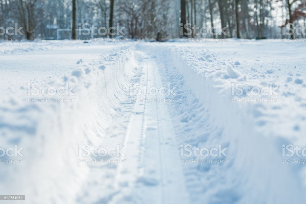 Tyre track in the snow stock photo