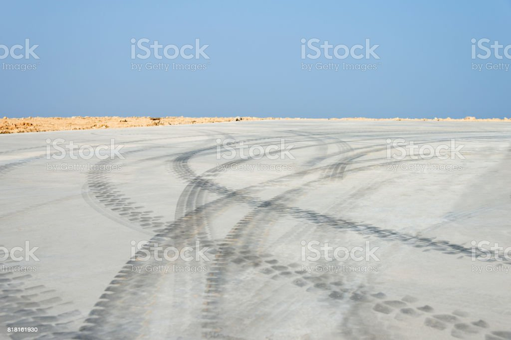 Tyre track road and sky stock photo