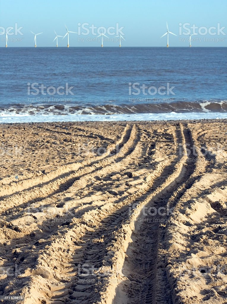 Tyre tracks and wind turbines royalty-free stock photo