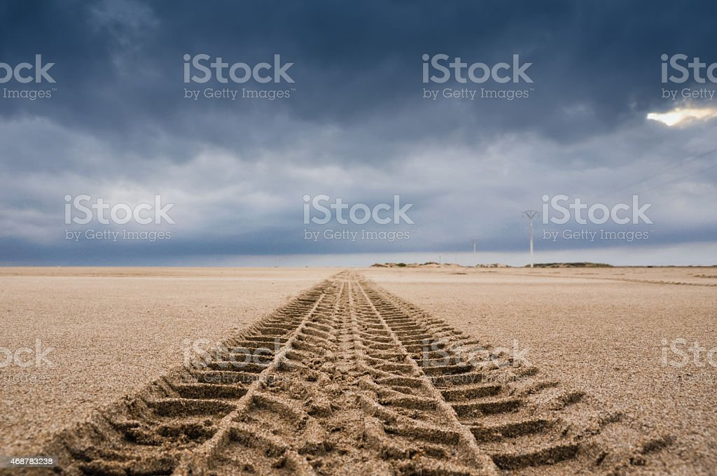 Tyre tracks on the sand of the beach stock photo
