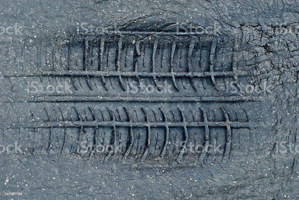 Tyre tread imprint in asphalt royalty-free stock photo