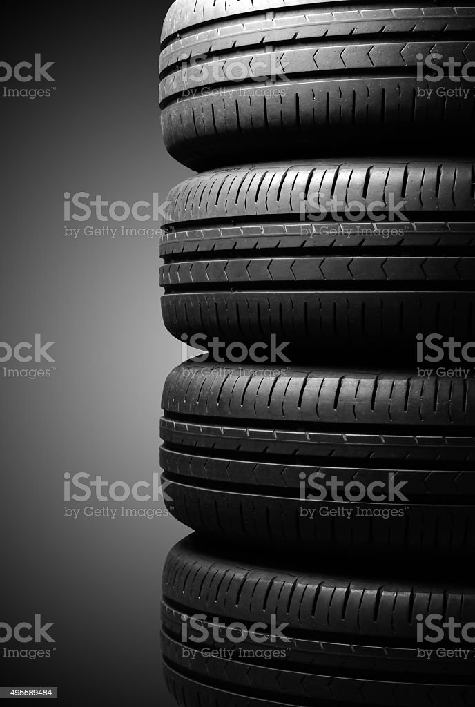 Tyres in dramatic lighting stock photo