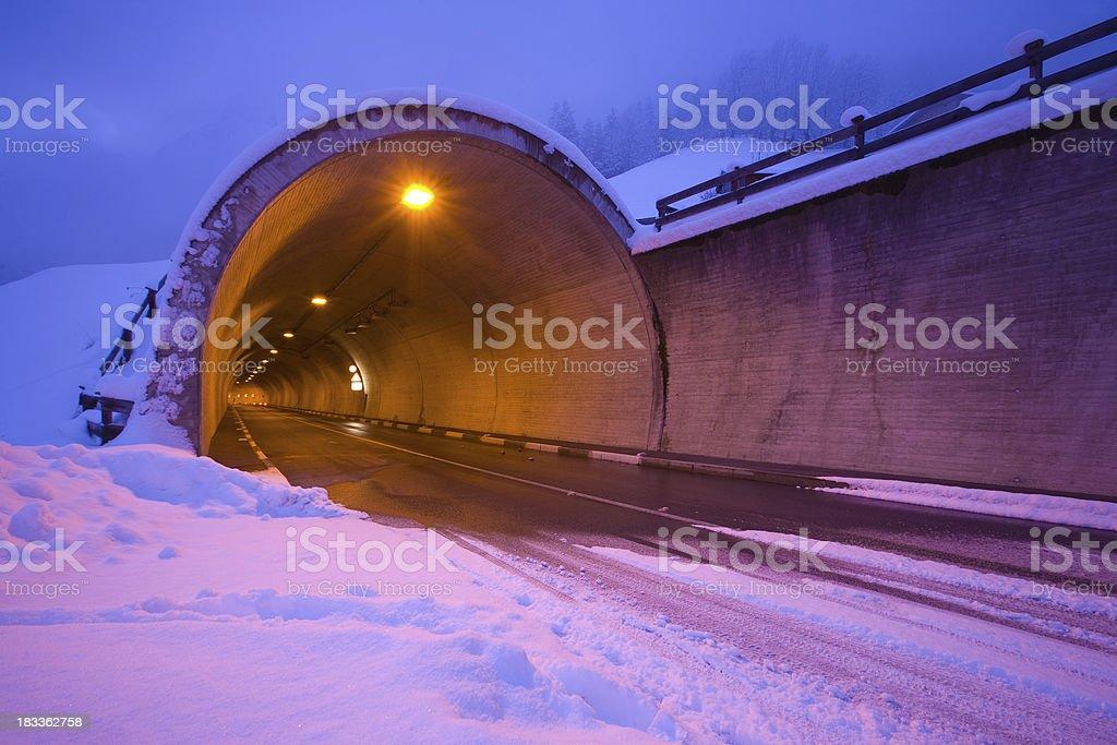 tyrolean tunnel, frozen winter road stock photo