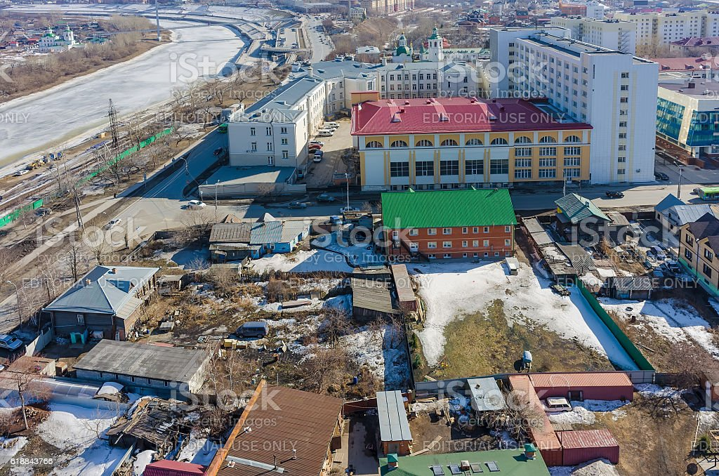 Tyumen industrial university and private houses stock photo