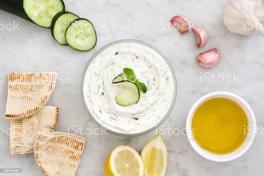 Tzatziki and ingredients stock photo