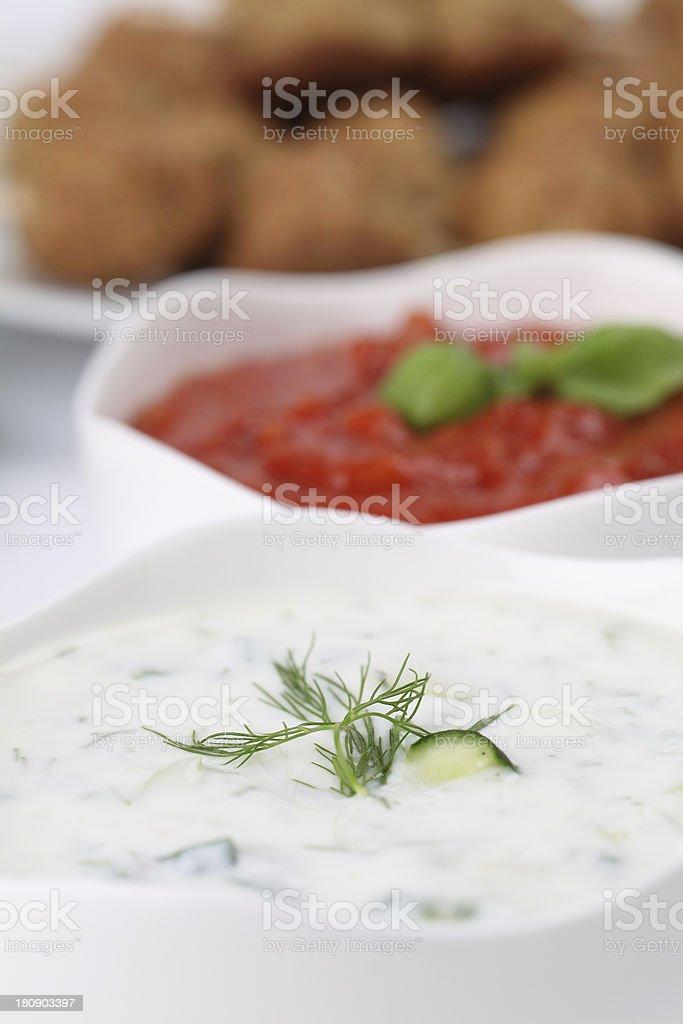 Tzatziki and tomato sauce stock photo