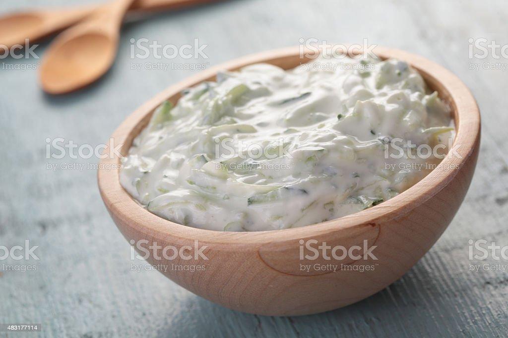 Tzatziki in a wooden bowl stock photo