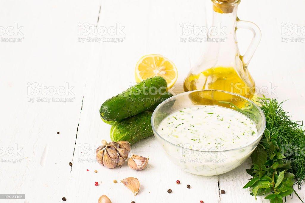 Tzatziki - traditional greek sauce a glass plate stock photo