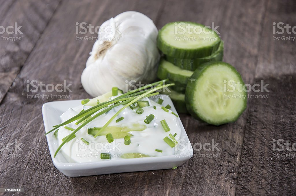 Tzatziki with ingredients in a bowl stock photo
